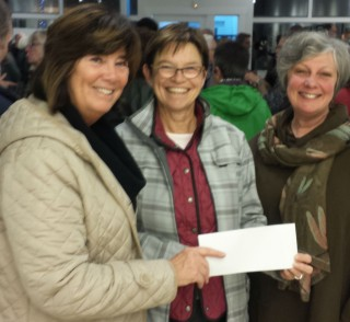 Kathryn McCarroll presents 2015 infrastructure grant to Board executives Caroline Davies and Sharon McGladdery