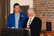Nominators John LeRoux and Thaddeus Holownia celebrate A Man of Letters.